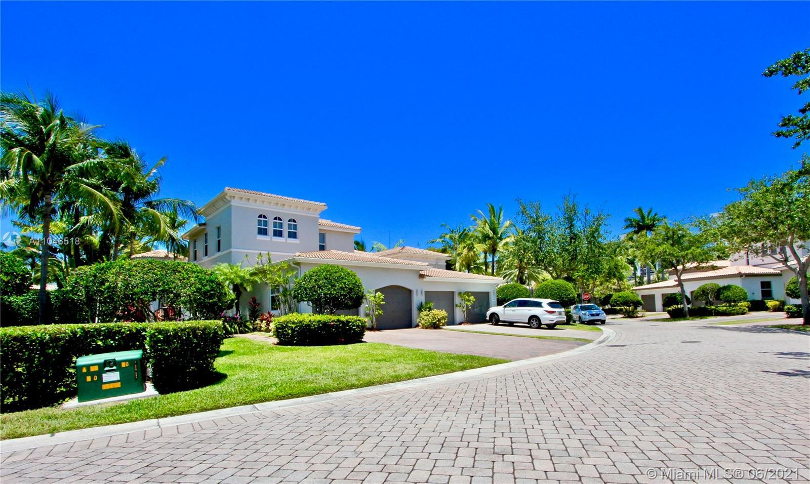 LIVE THE SOUTH FLORIDA LIFESTYLE IN A LOVELY COMMUNITY OF HARBOR ISLAND - LOCATED IN A 24-HR GATED C