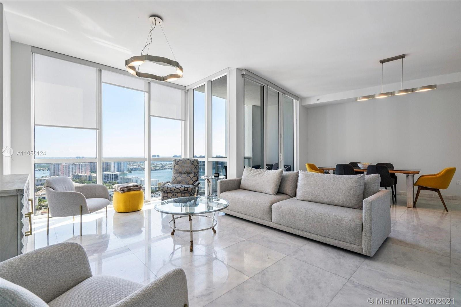 Lots of floor to ceiling windows and natural light from this wide floorplan featuring two bedrooms,