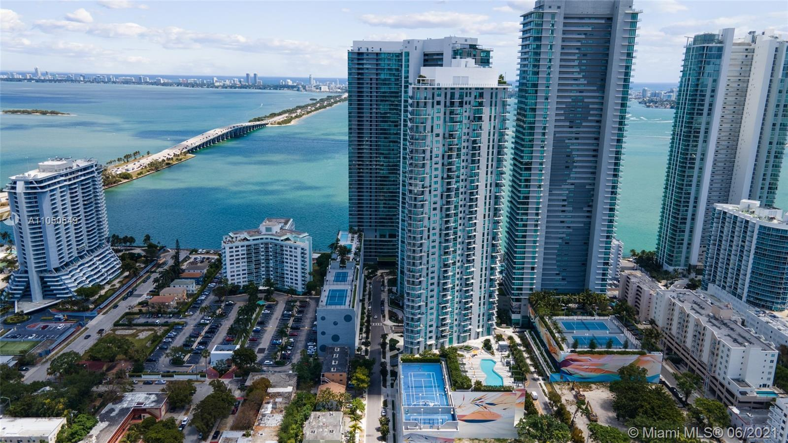 SPECTACULAR BAY AND OCEAN VIEWS FROM THIS SUPER BRIGHT AND SPACIOUS ONE BEDROOM APARTMENT + DEN AT T