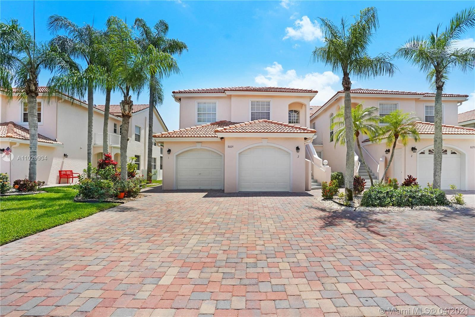 Boca living at its finest!  Bright and open 3 bedroom, 2 bath coach home in the heart of Boca! You w