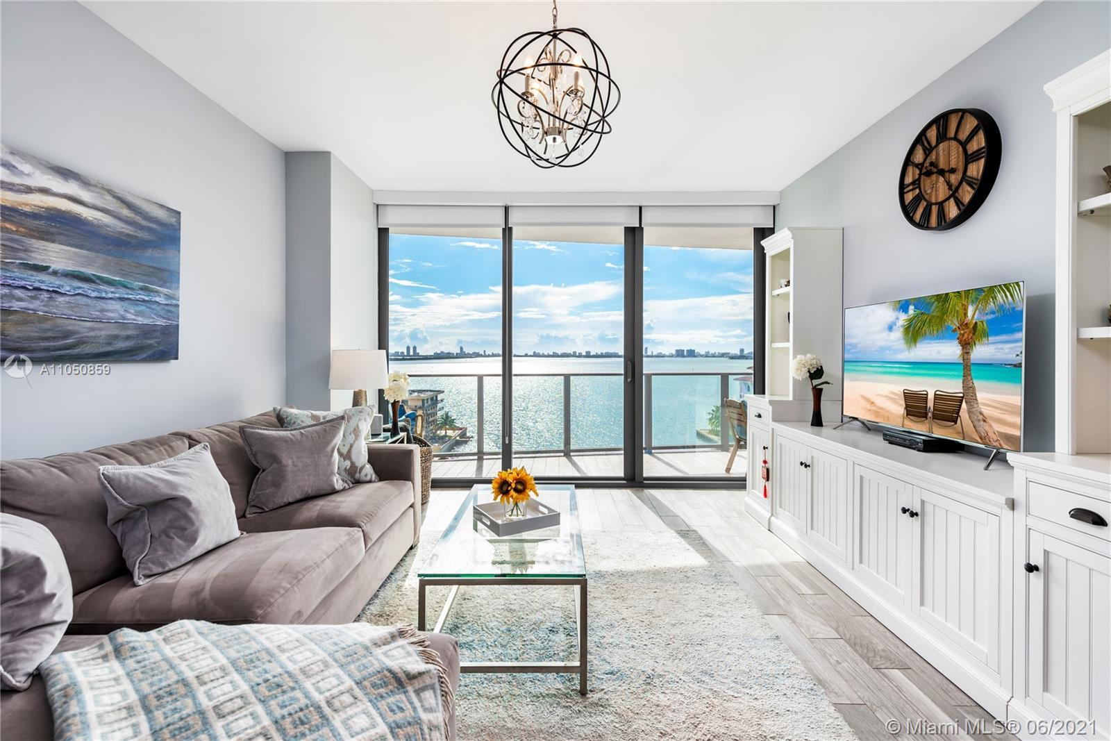 Stunning sunrise/wide bay views from this ultramodern 2br apartment at highly-desirable Icon Bay. A