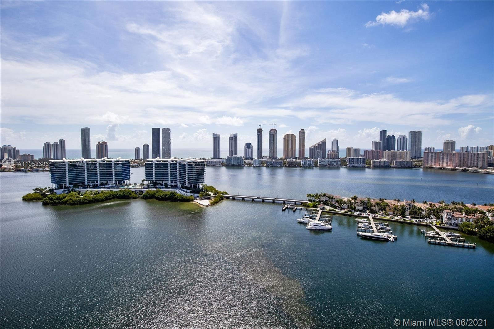 Amazing East and West water views surround this unique 5,954 sq. ft. unit in Peninsula I. Private el