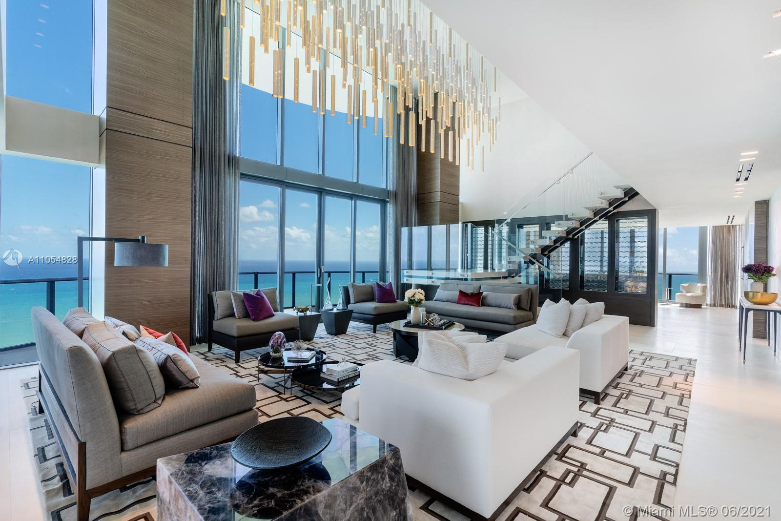 When you step inside this penthouse, you're greeted with boundless light from a 20-ft high great roo