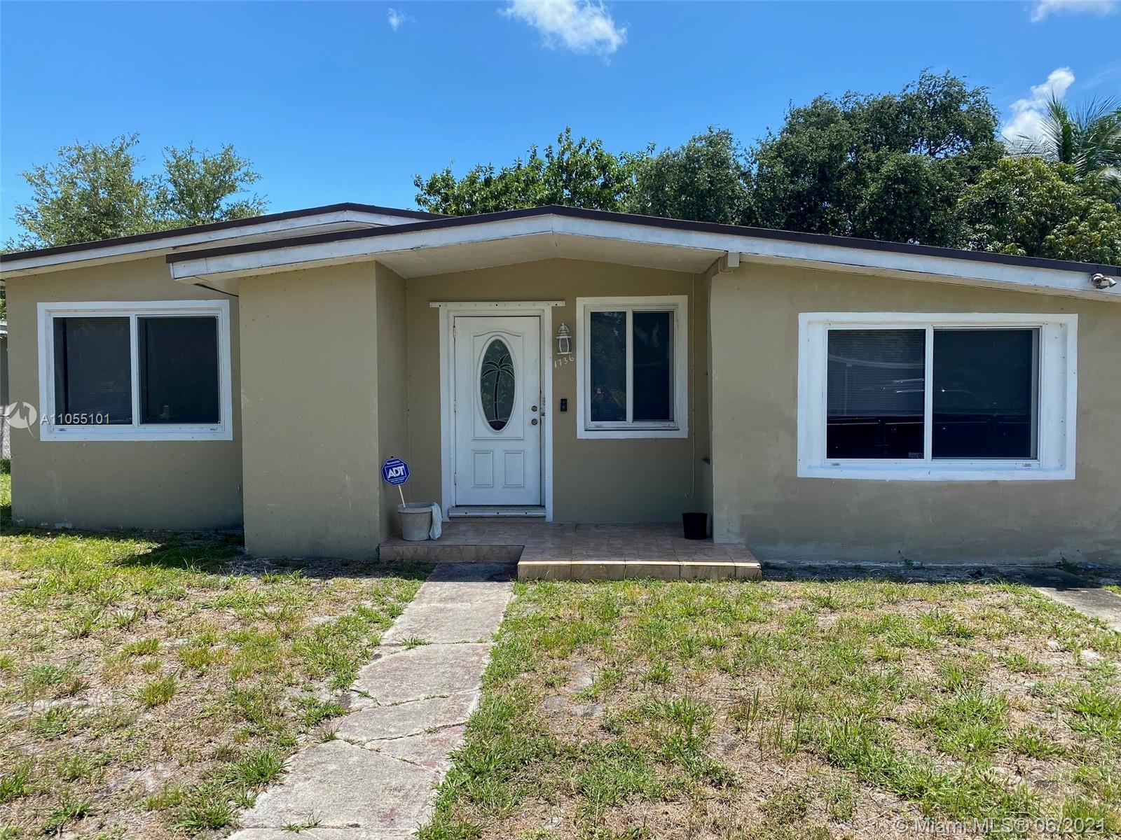 Beautiful 4/2 Completely Renovated with Hurricane Impact Windows. Beautiful kitchen with updated bat