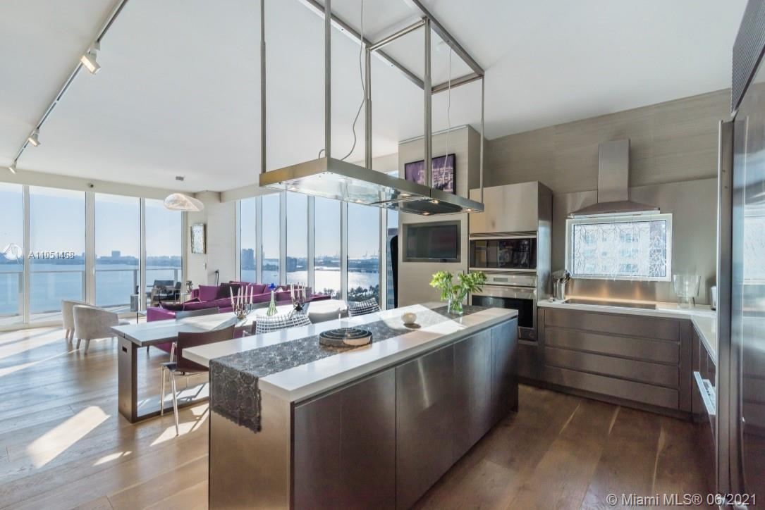 UNIQUE FLOW-THRU CORNER UNIT WHERE NO EXPENSE HAS BEEN SPARED.THIS 3 BED, 3 BATH FEATURES WOODEN FLO