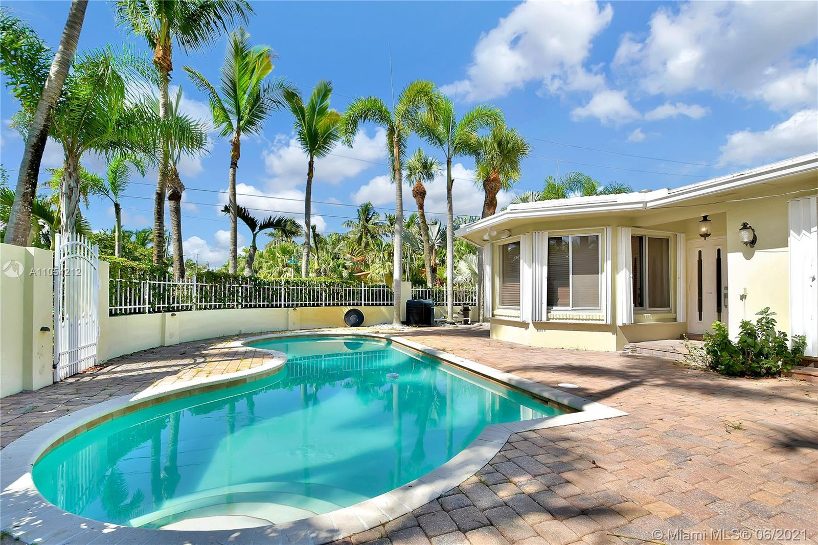 Charming beach home with lush landscaping, spacious outdoor area and pool on a private corner lot, j