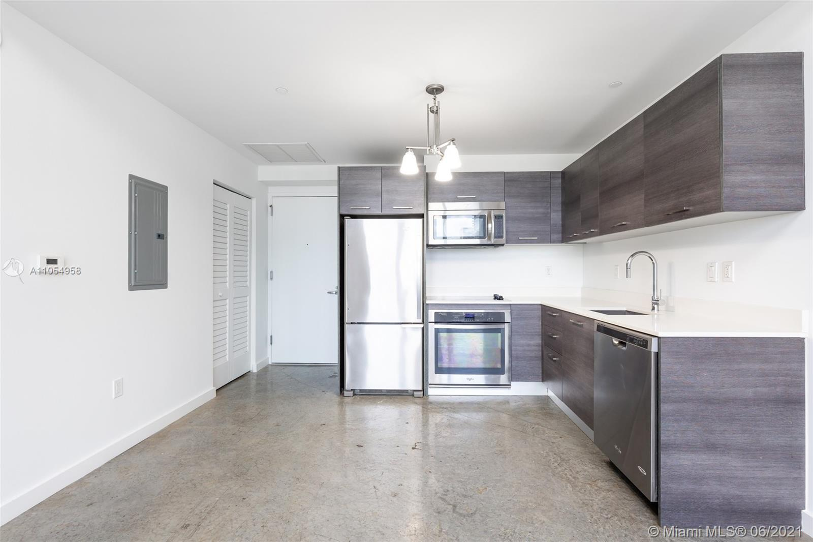 Loft-style condo with city views at Centro. This unit features kitchen with stainless steel Whirlpoo