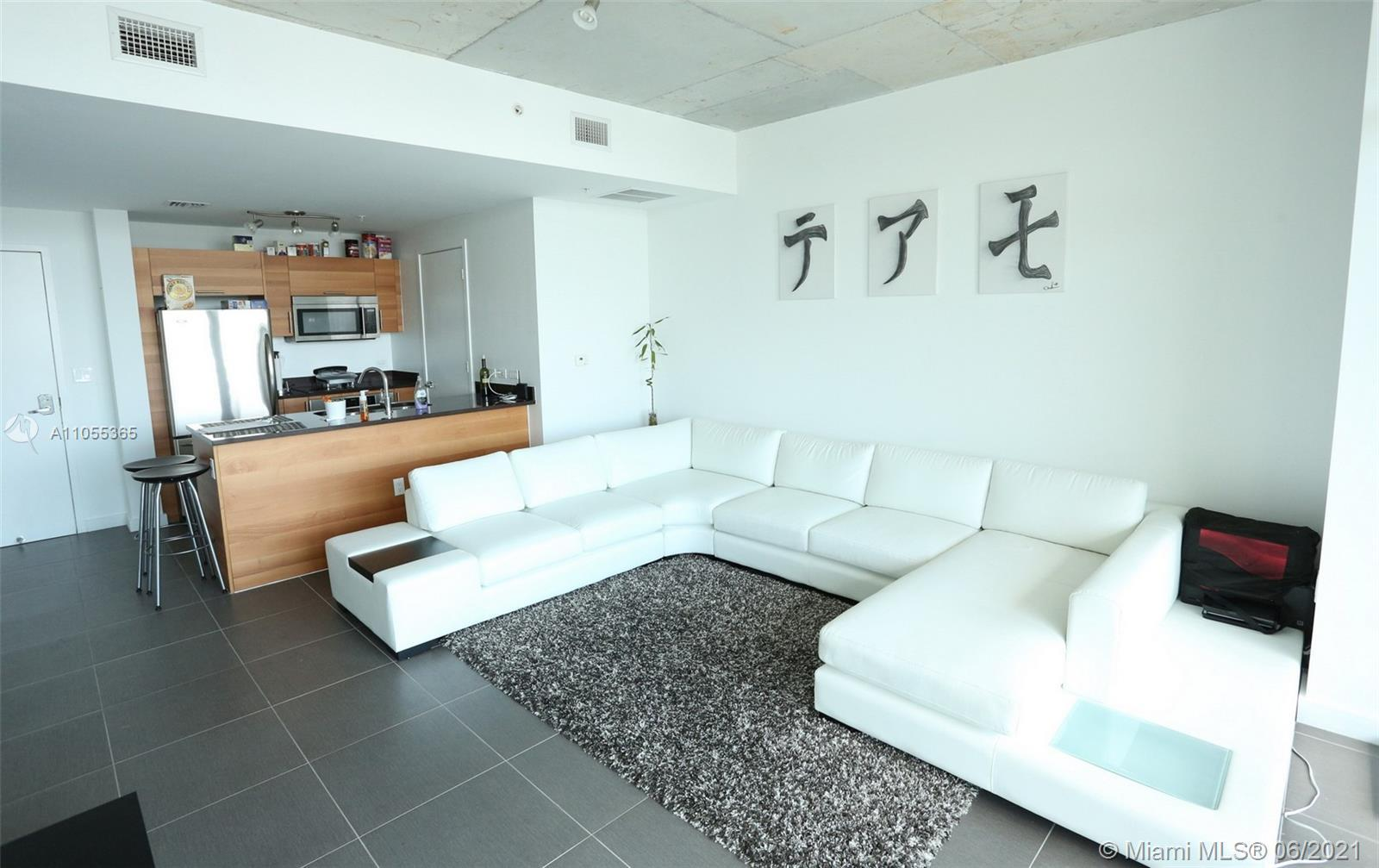 Beautiful and bright one bedroom with tile flooring throughout, features a gourmet chef kitchen, flo