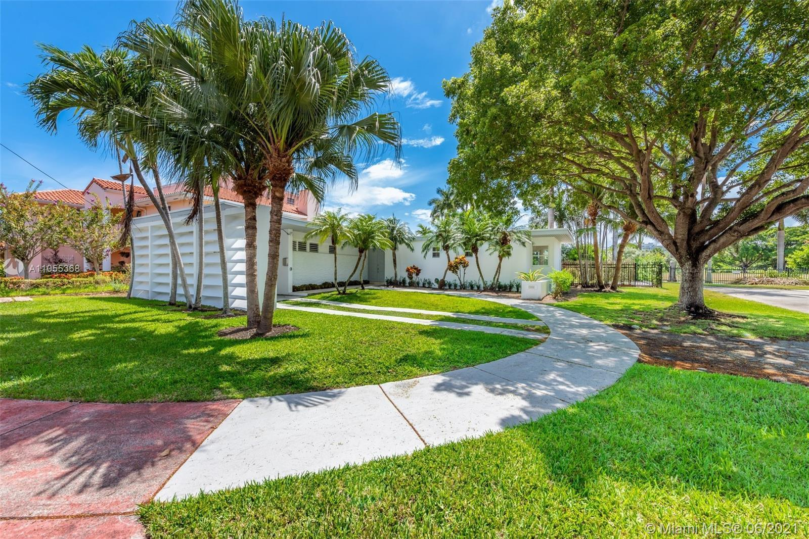 This sun drenched home, on a private cul de sac, is nestled against La Gorce Country Club and featur