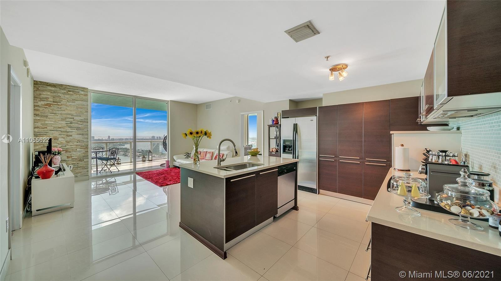 Live and enjoy the true Miami lifestyle from this 2 bedroom residence that offers breathtaking unobs
