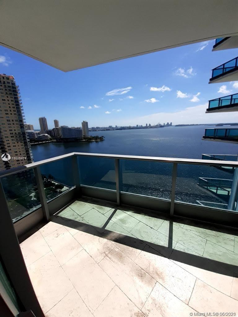 UNIQUE CORNER UNIT IN BEST RESIDENTIAL BUILDING IN BRICKELL. OPEN BAY VIEWS FROM LIVING ROOM AND BED