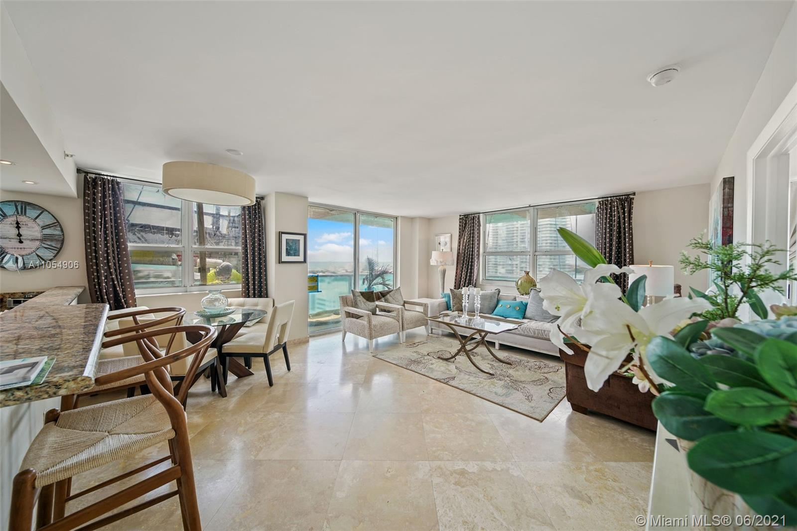 Corner Unit with wraparound balcony and extended terrace offering floor-to-ceiling glass in living r