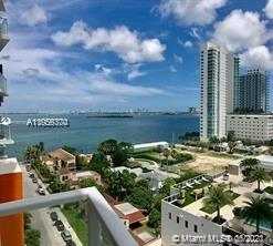 Corner unit with Biscayne Bay and Miami Skyline views from the 10th floor located at THE CRIMSON bui