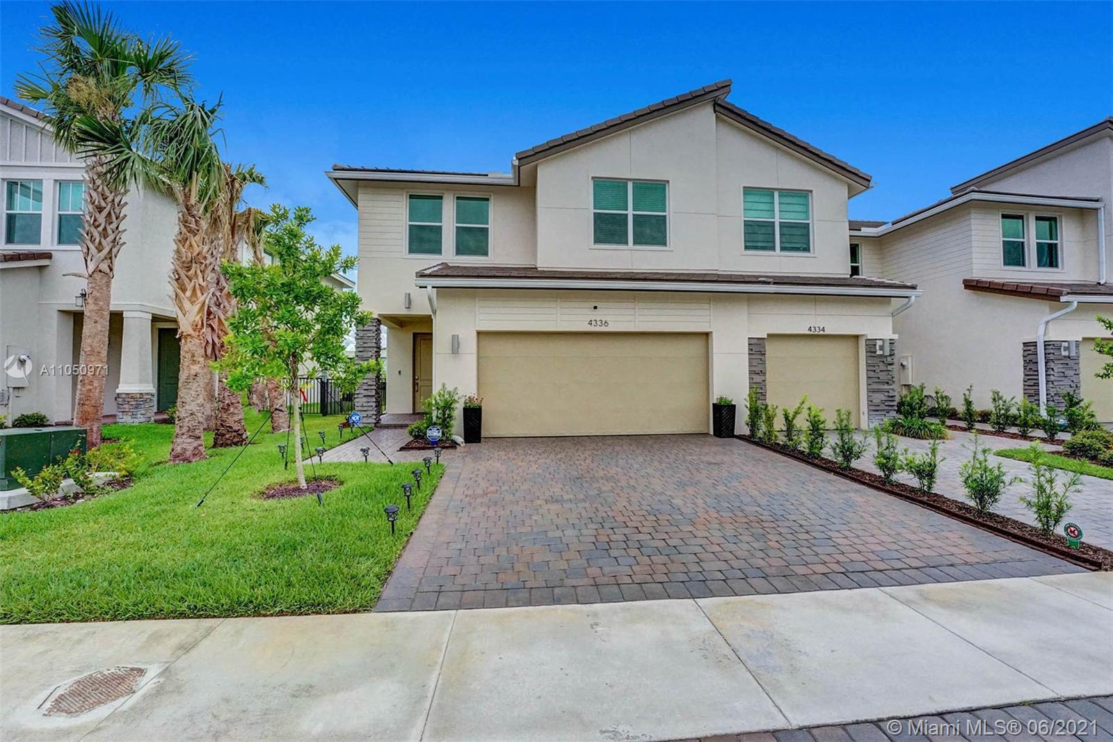 This won't last!  Stunning spacious 3 Br 2 .5 bath Townhome ; Bussola model , Gated community ; Gour