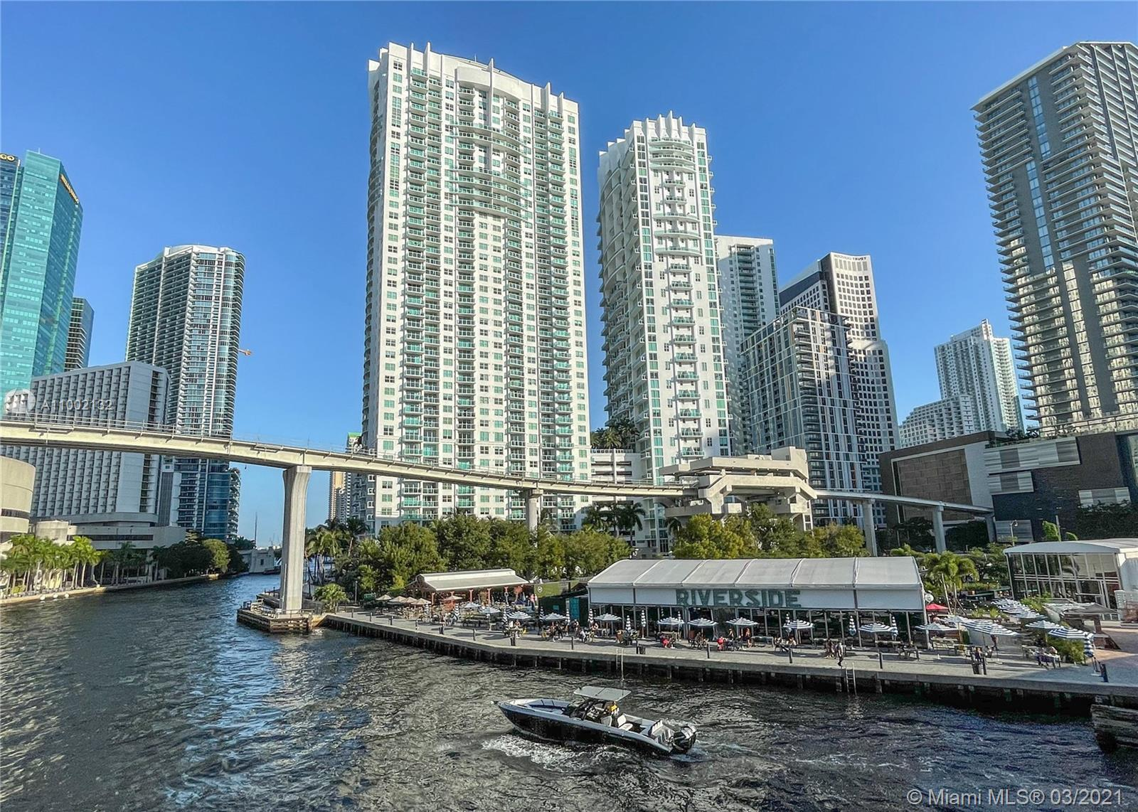 Fabulous water and city views! This amazing 2-story sky-loft unit in the luxury, full-service Bricke