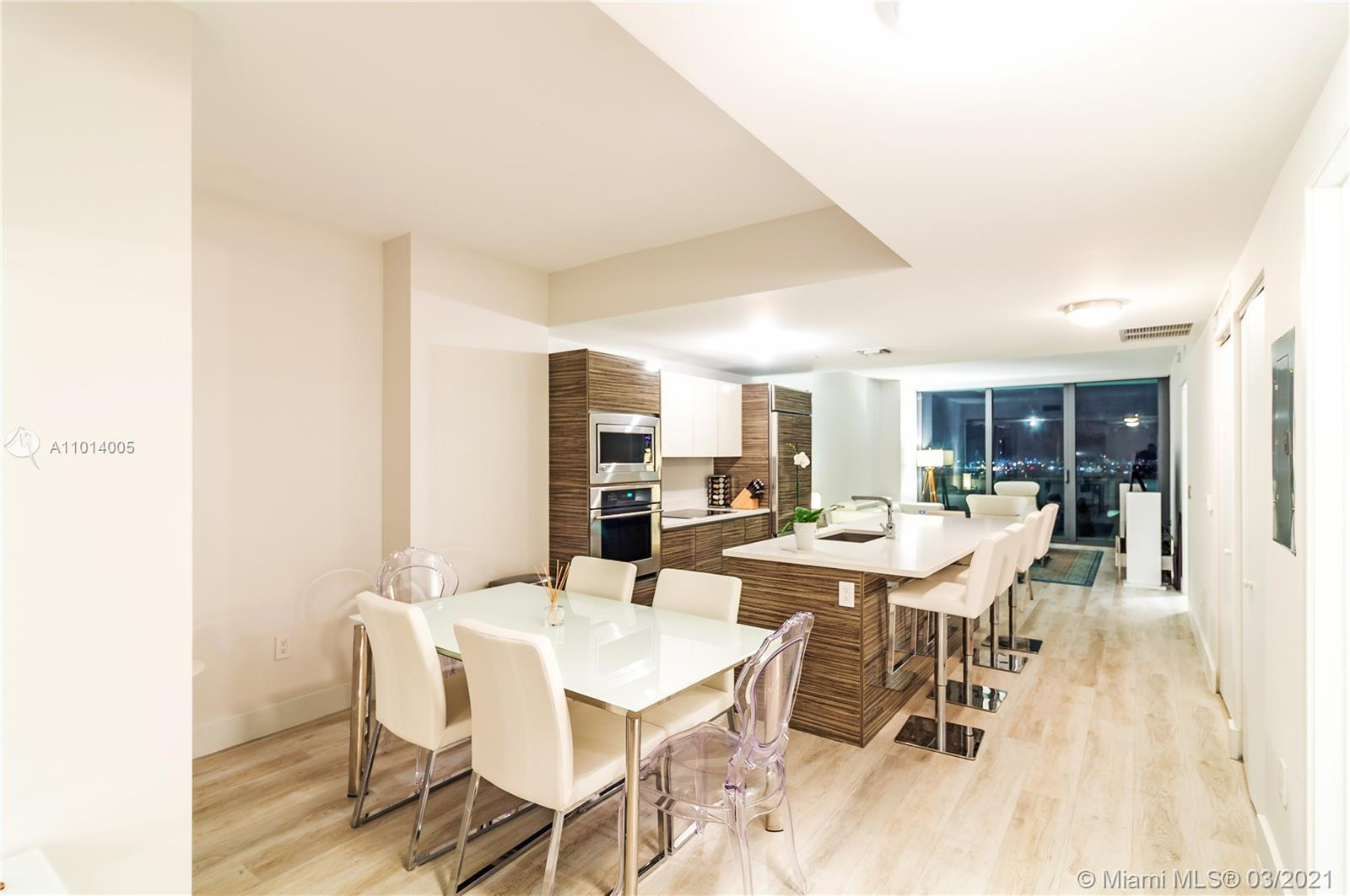 Exquisite Unit in an exclusive building in the heart of Edgewater. Modern furniture and top of the l