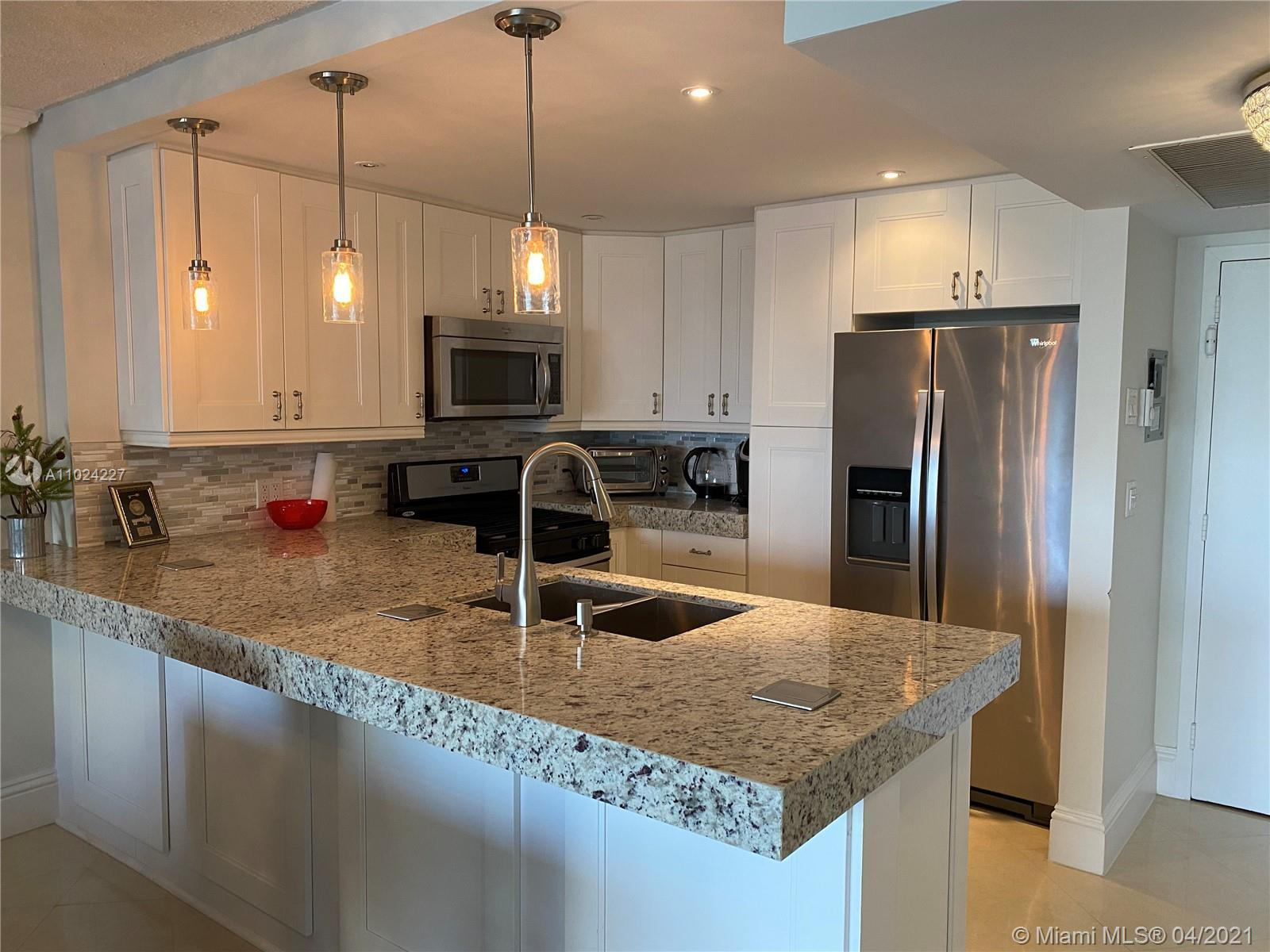 COMPLETELY REMODELED UNIT FEATURES, DESIGNER KITCHEN, REMODELED FULL AND HALF BATHROOMS. ALL TILED F
