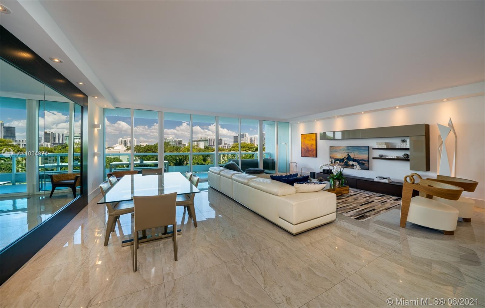 Spectacular totally upgraded and remodeled residence. This  Masterpiece offers 2,100 sq.ft. of livi