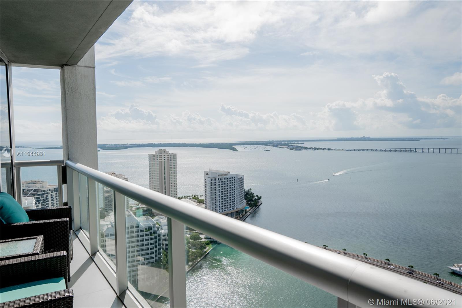 Highly sought after corner unit with breath taking views of the bay, downtown & the surrounding isla