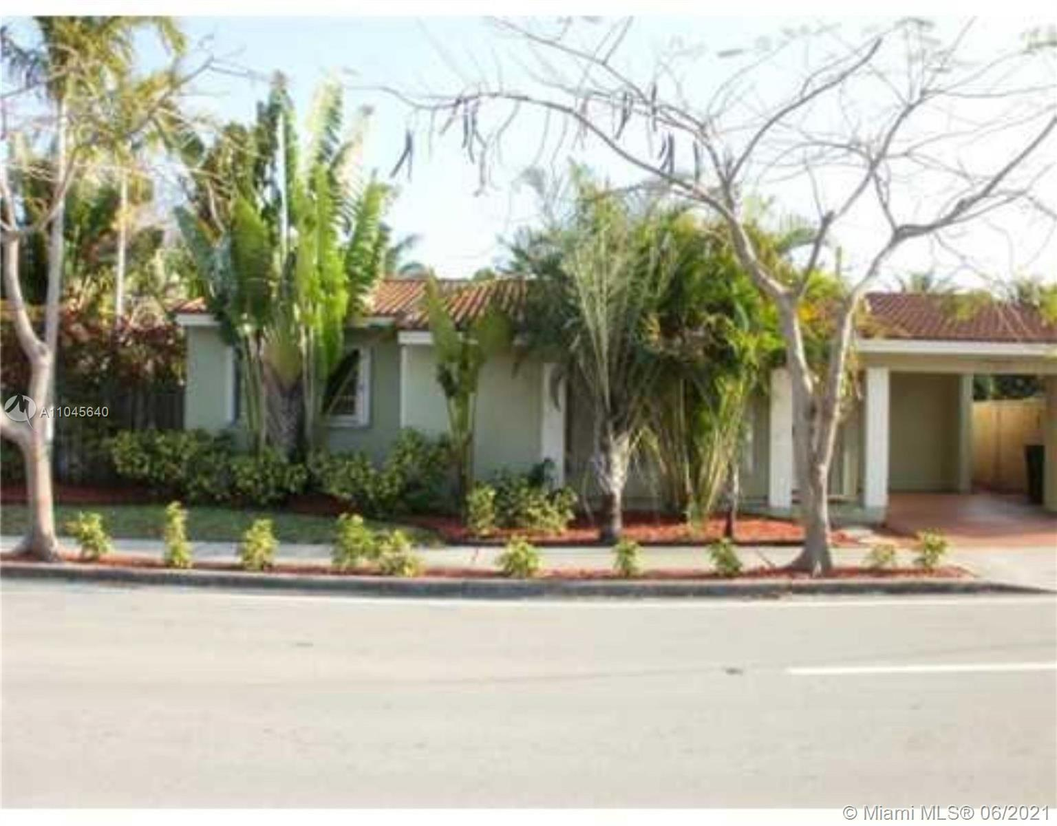 Rarely available 4 bedroom 2 bathroom house on a corner lot perfectly located just north of Sunrise