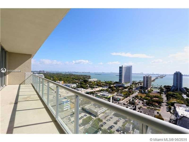UNOBSTRUCTED BAY VIEWS FROM EVERY ANGLE. High floor unit with 9.5' ceilings, both bedrooms feature e