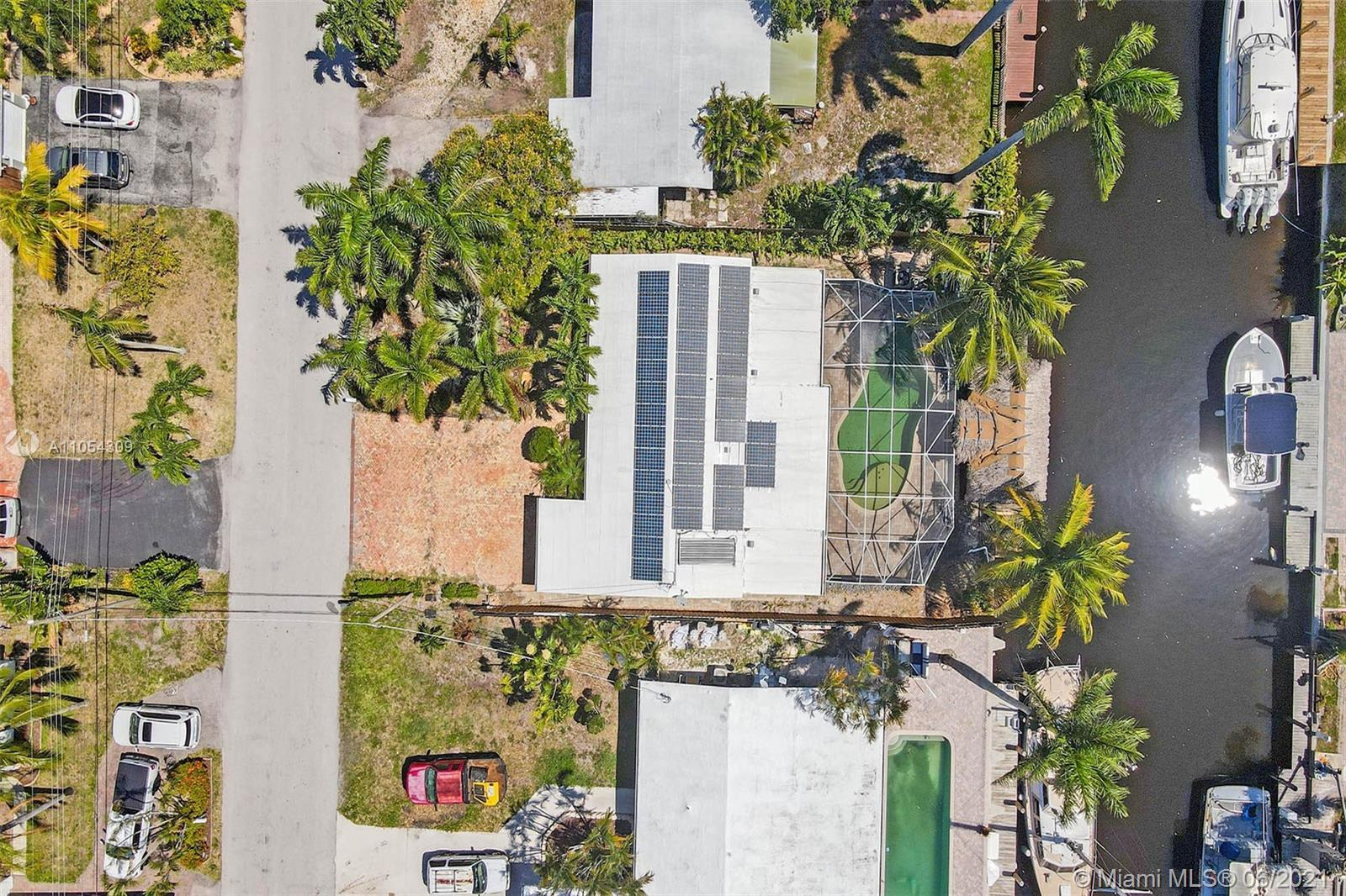 Lush, Tropical, Waterfront Oasis in sought after Lauderdale Isles, absolute best price in community!