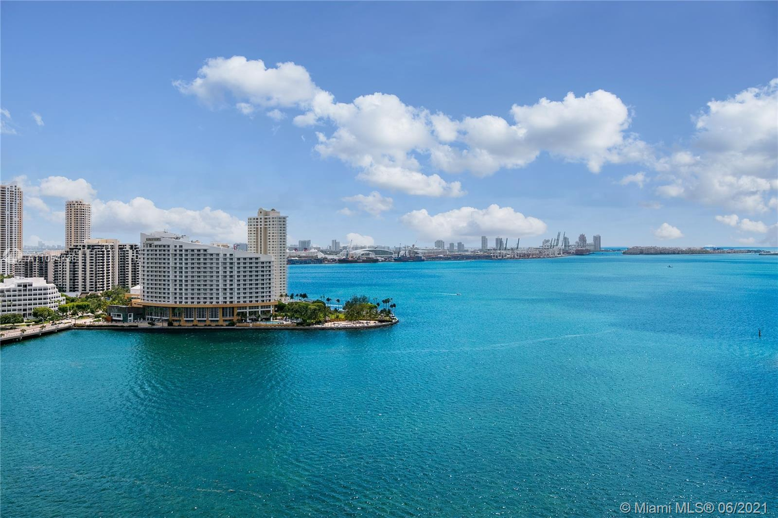 Enjoy Water Views Forever from this 3 Bedroom, 2 Bath Condo located in the Heart of Miami's Financia