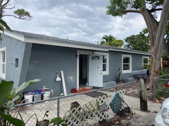 Beatifully Remodeled 4/2! Brand new roof, impact windows, brand new floors, new kitchen, new baths,