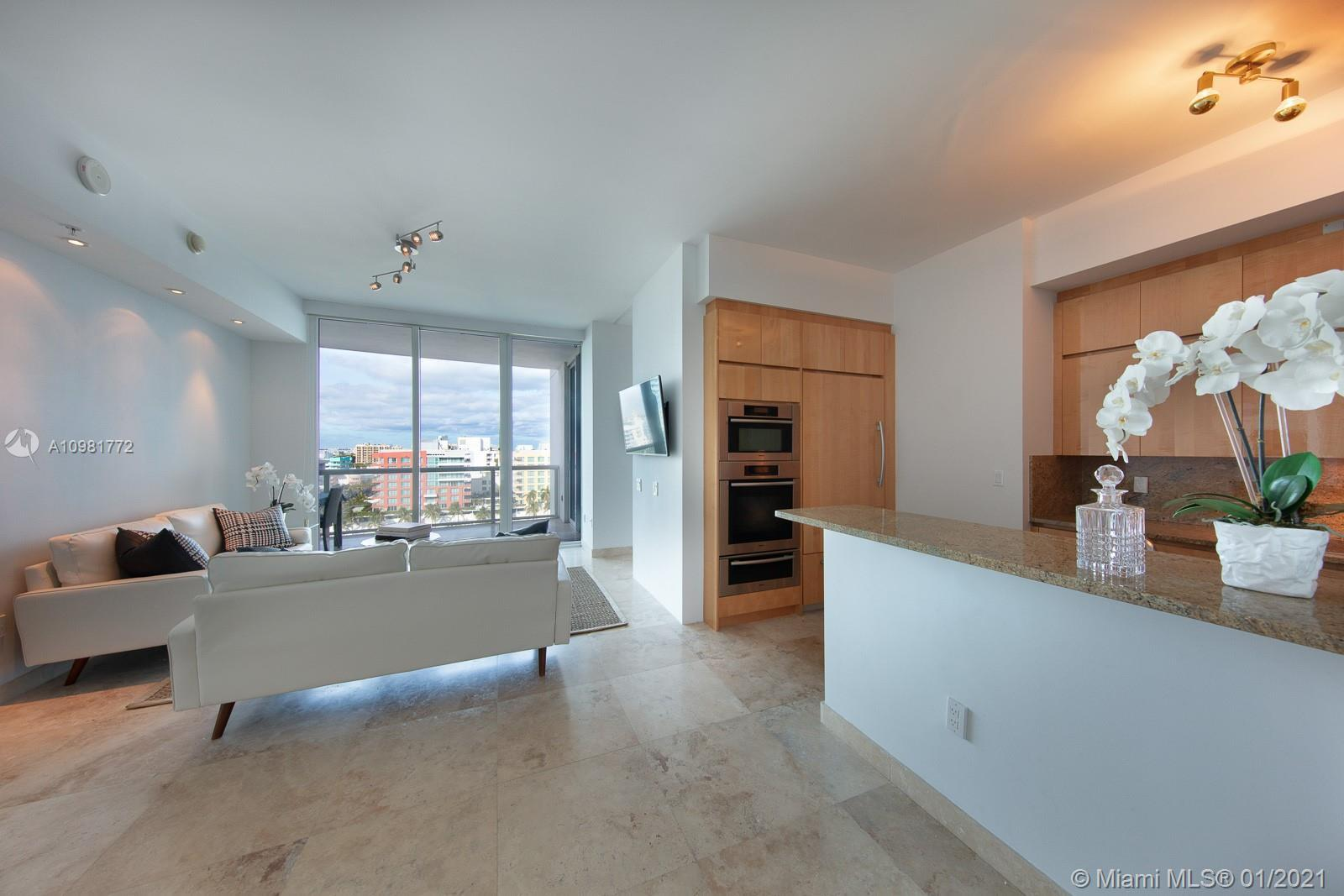 Sunlight filled 2 bedrooms and 2.5 baths split floor plan with private foyer, marble floors, 10' cei