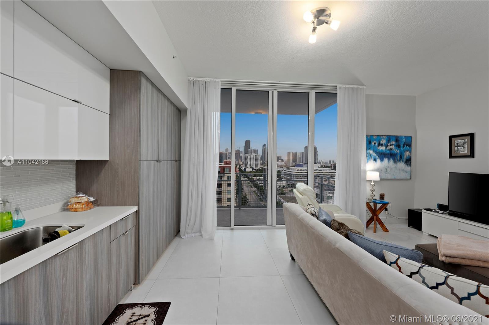 REMODELED CORNER CONDO WITH SOUTHWEST VIEWS.REPLETE WITH UPGRADES: BRAND NEW OVERSIZE PORCELAIN FLOO