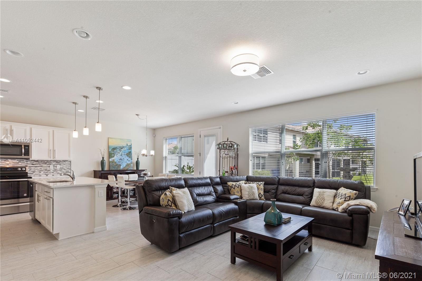 NEWER CONSTRUCTION 3 BEDS 2.5 BATHS RARITAN MODEL TOWNHOME, FEATURING UPGRADED KITCHEN, WOOD-LIKE TI