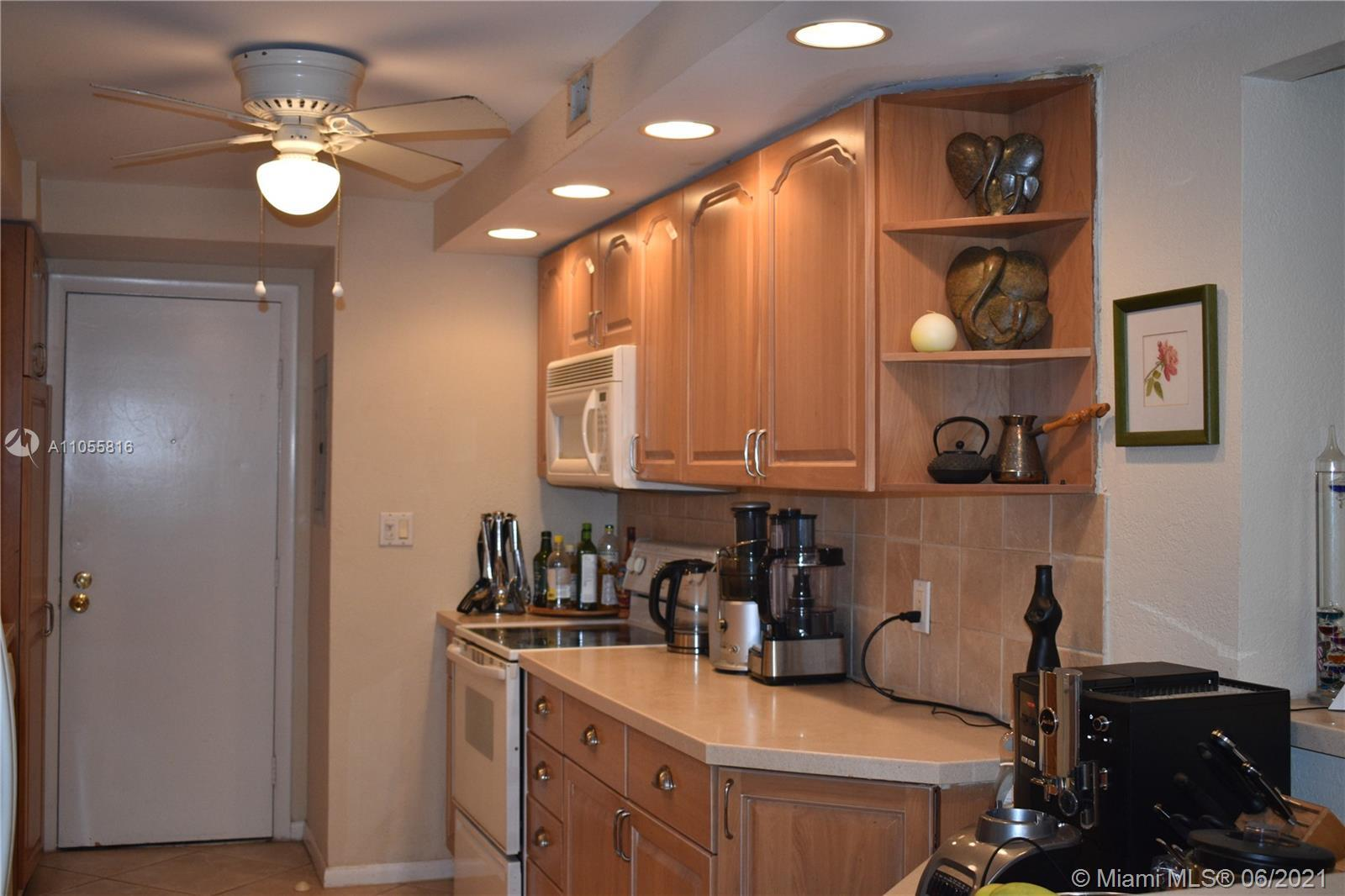 This is a two bedroom, two bath remodeled unit, light neutral wood kitchen cabinets with ceramic til