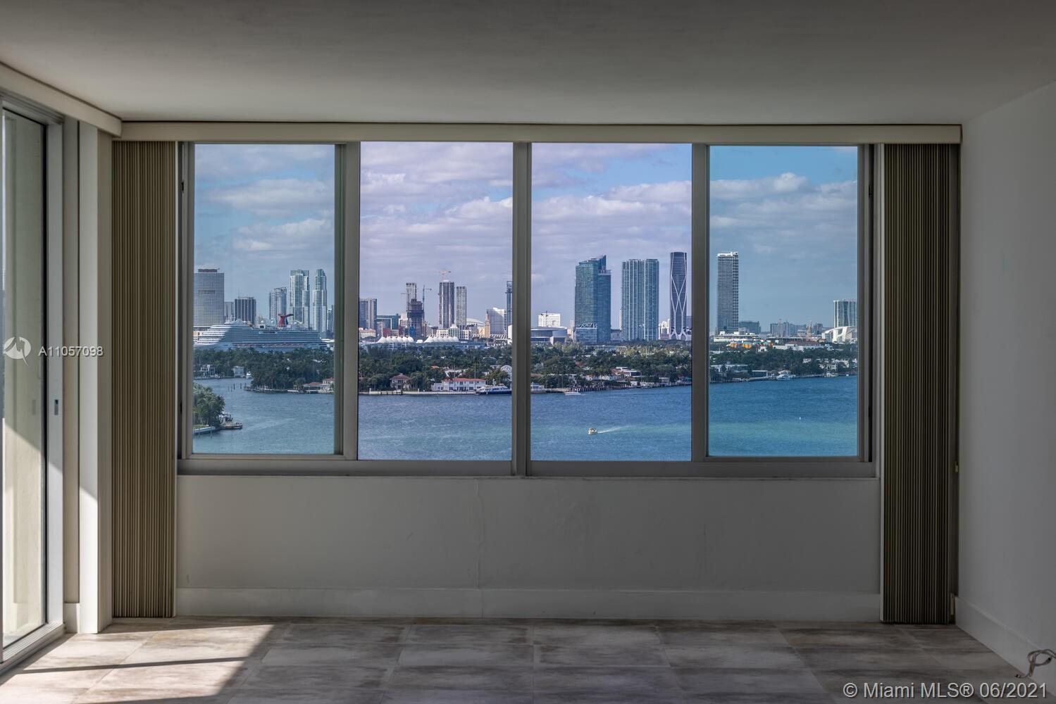 Enjoy spectacular Biscayne Bay, Port of Miami and Downtown views from this bright 1 bedroom/1.5 bath
