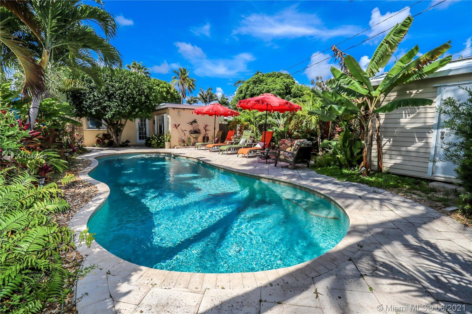 Charming Home ~ Tropical Paradise! In Desired Neighborhood.....East of US1!  3 BD / 2 BA Home with a