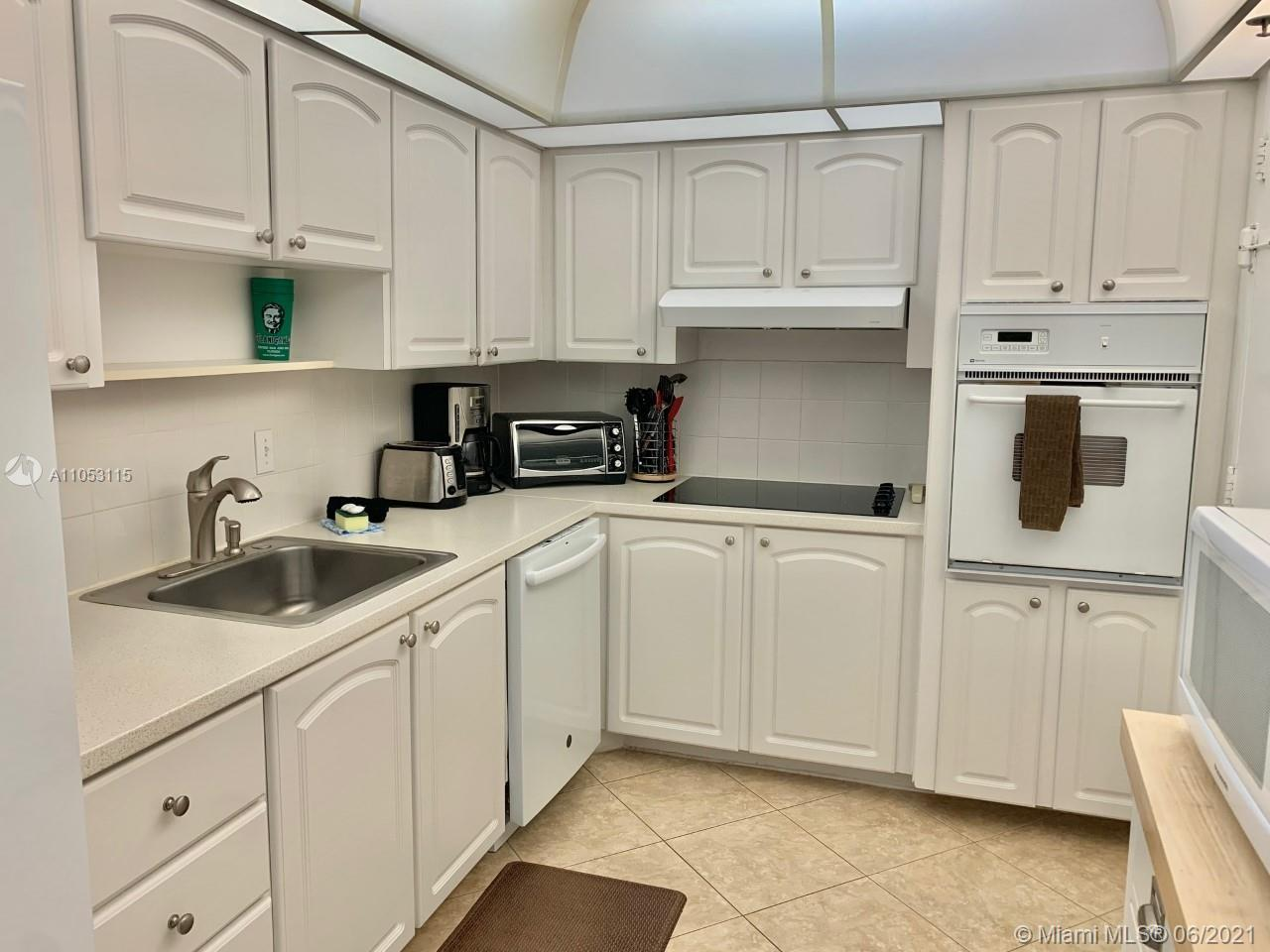 PRISTINE CONDITION 1/1 DIRECTLY ON THE BEACH! UPGRADED BATHROOM, TILED FLOORS THROUGHOUT, FURNISHED
