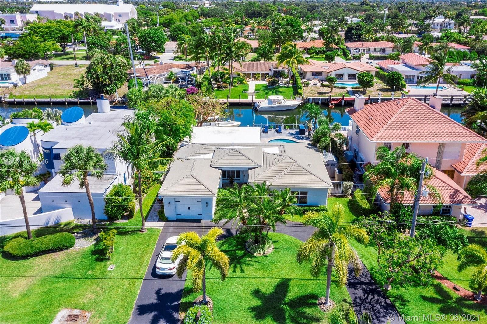 Boater's Dream Home! 87 feet of waterfront on one the best canals south of the Inlet! Tropical Parad