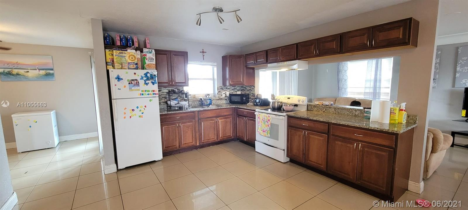 House ready to move in  Updated Kitchen Large Tile throught the wntire house  amazing backyard p