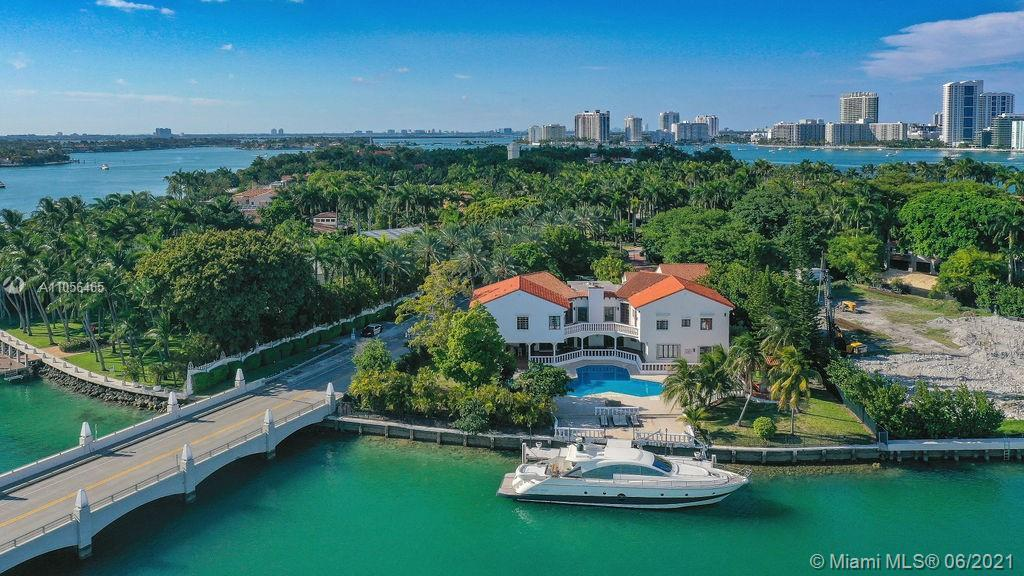 LIVE THE DREAM!!!  This rarely available waterfront opportunity is protected by a guard gate and  in