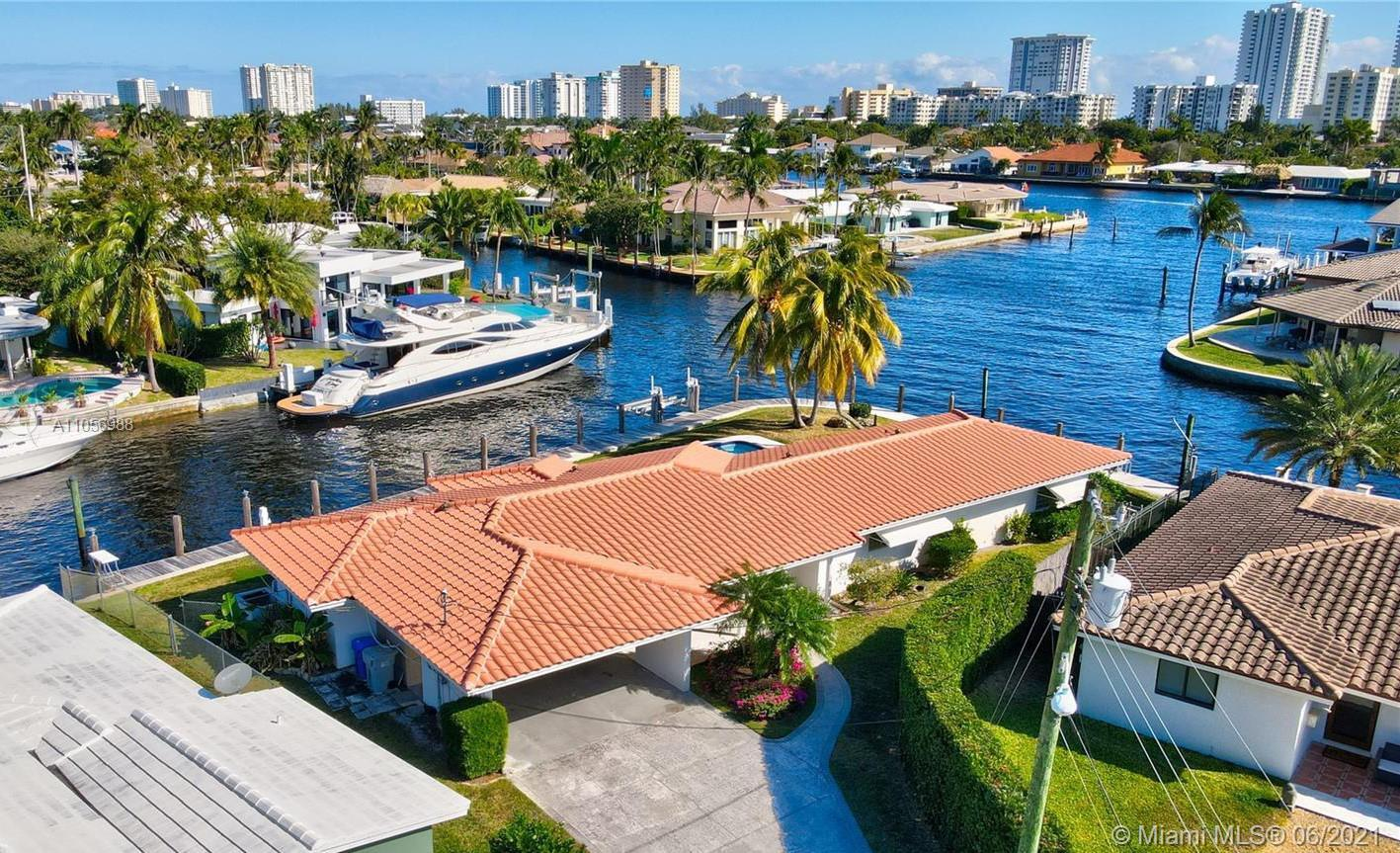 A rare opportunity to own a private point lot in Pompano Beach with over 200 feet on the water and w