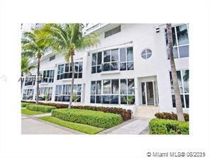 GREAT INVESTMENT! Beautiful townhome w/the best upgrades including solid teak wood floors & stainles