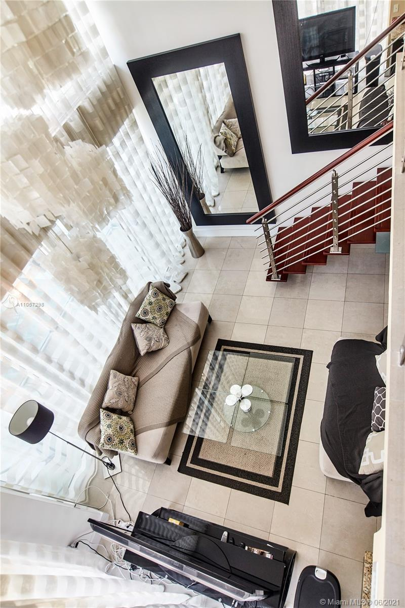 Perfectly situated 2 bedroom 2 bathroom Loft style condo in Brickell on the River. Corner unit with
