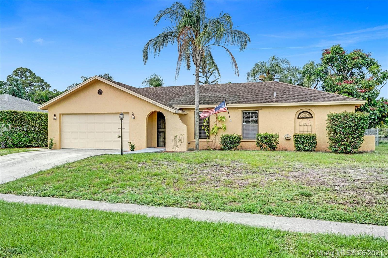 A true gem centrally located with an open and spacious layout and a lush, tropical backyard on a can
