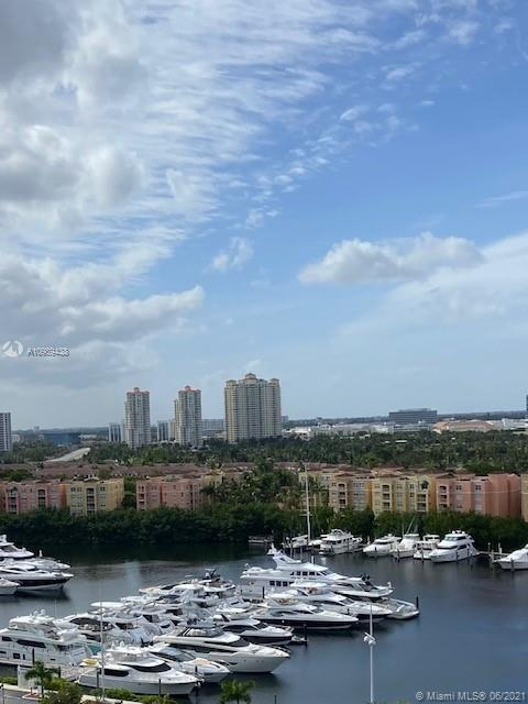 BREATHTAKING VIEWS FROM THIS SPACIOUS 2 BEDROOM 2 BATH UNIT IN TURNBERRY ISLE NORTH.  ENJOY THE INTR
