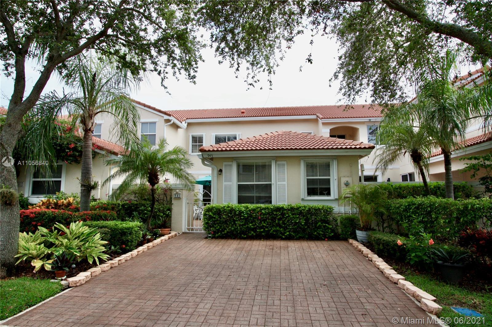 Beautiful townhome in gated community near beach & Downtown Hollywood is move-in ready. The eat-in k