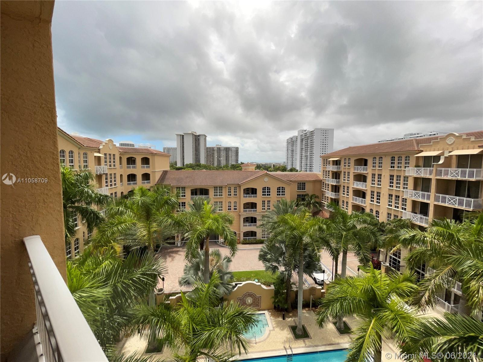 7 Story Mediterranean Style Condo Building with Pool Gym Dock and other amenities.