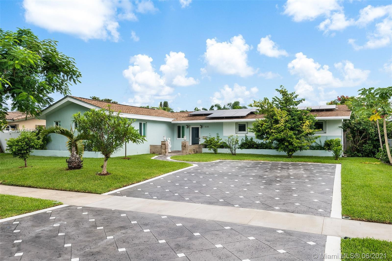 Pristine move in ready 3 BR 3 BA house in Hollywood Hills! This home features a master bedroom AND h
