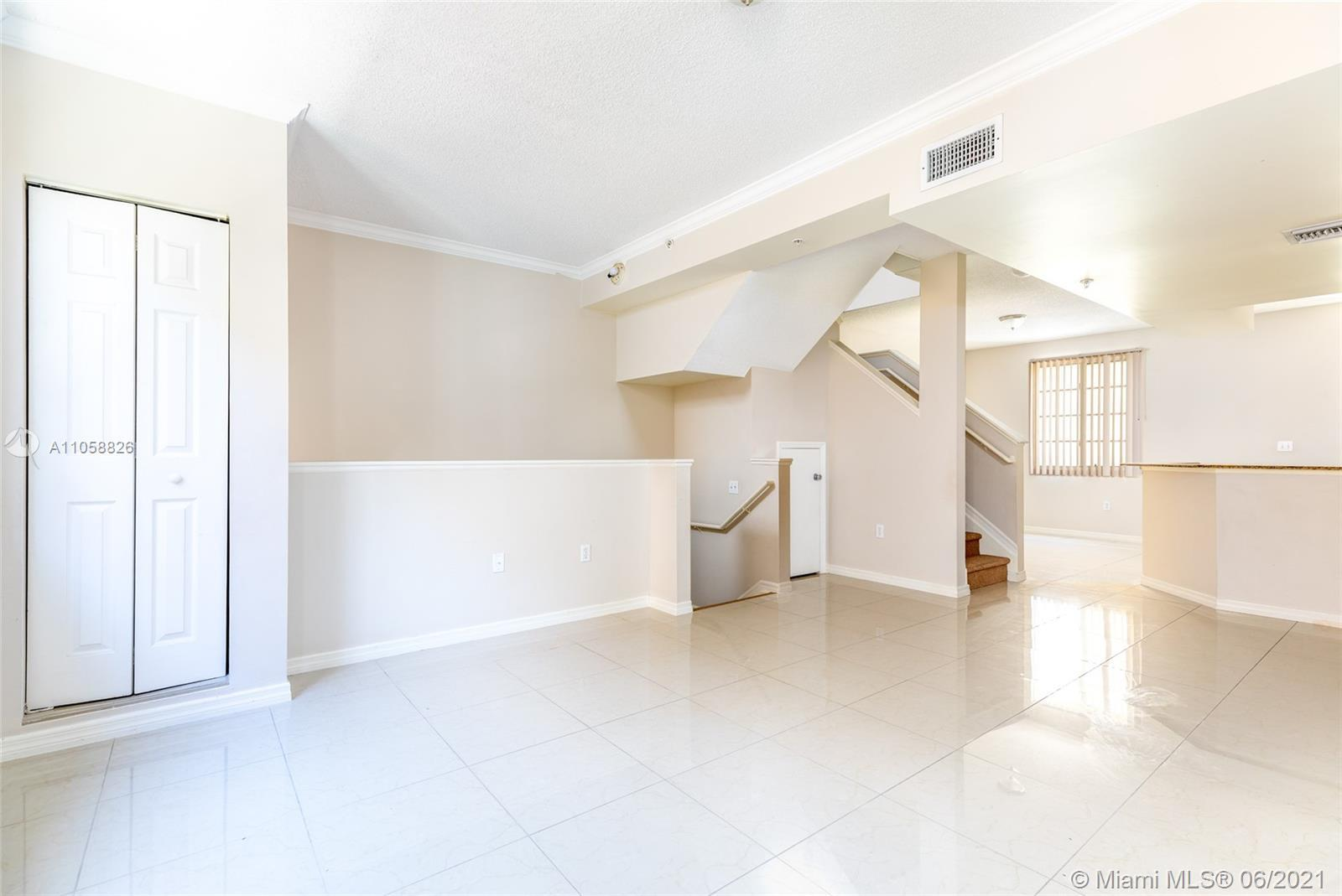 Private three-story townhouse in Aventura!!! This amazing townhome offers a large covered parking ga
