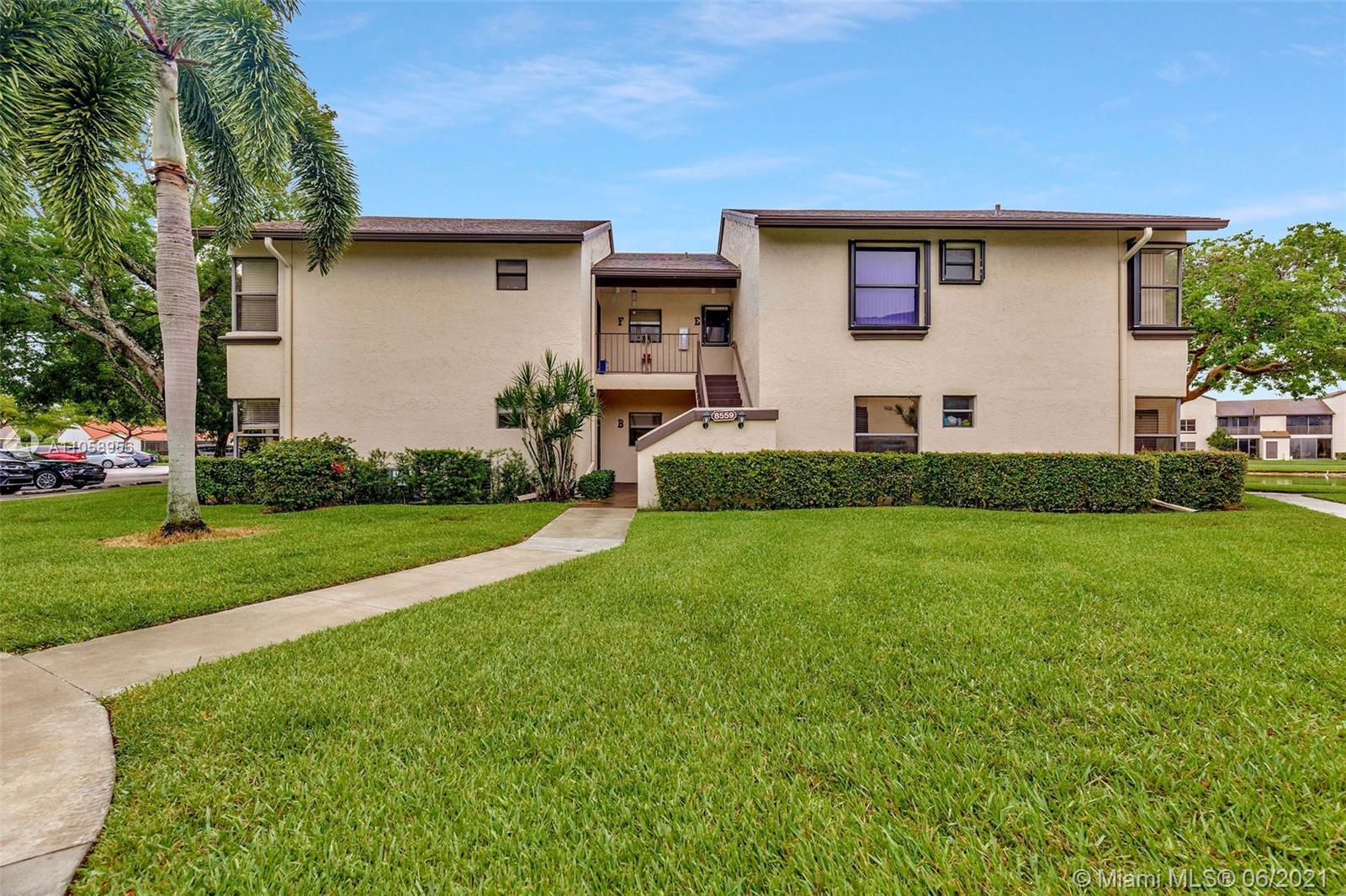 AMAZING OPPORTUNITY! BEAUTIFUL UPDATED 2 BEDROOM 2 BATHROOM, 1st FLOOR CONDO IS PERFECTLY NESTLED IN