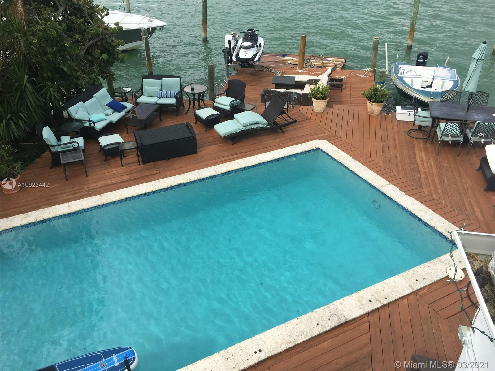 This 4/4 wide bay waterfront home with a dock, boat lift and jet ski lift has amazing wide bay view