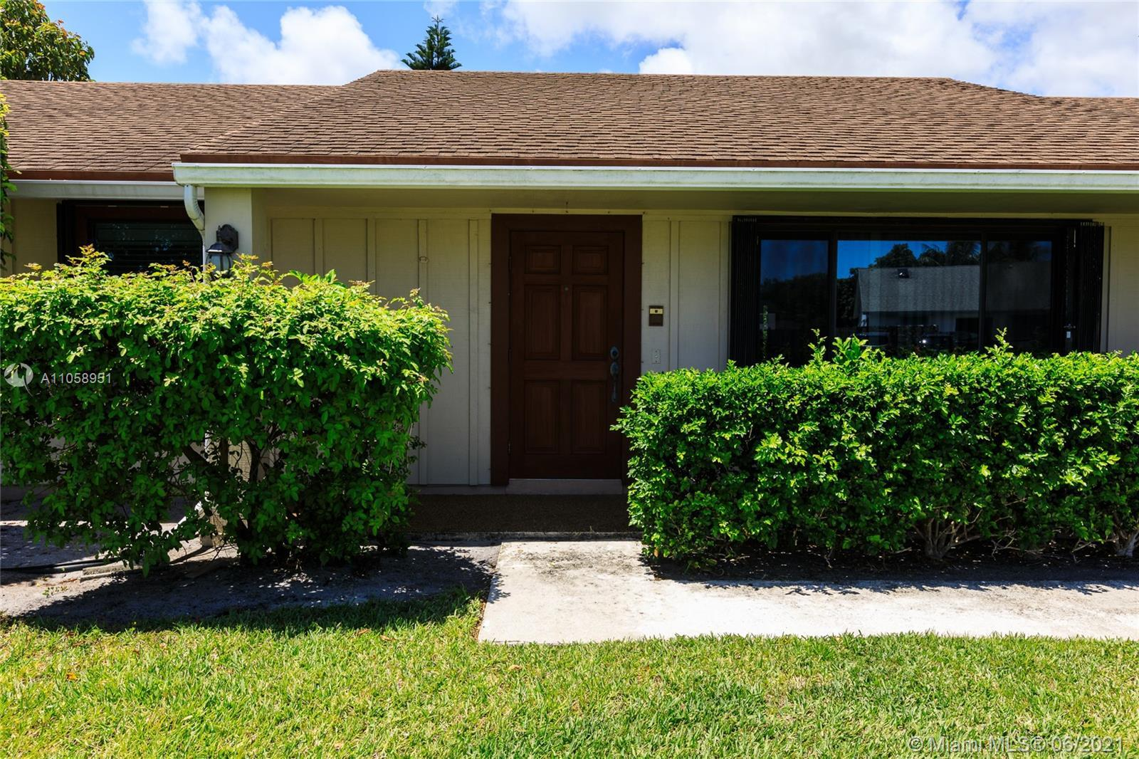 Ranch home in East Boca with big backyard and pool. The house features large bedrooms and vaulted ce